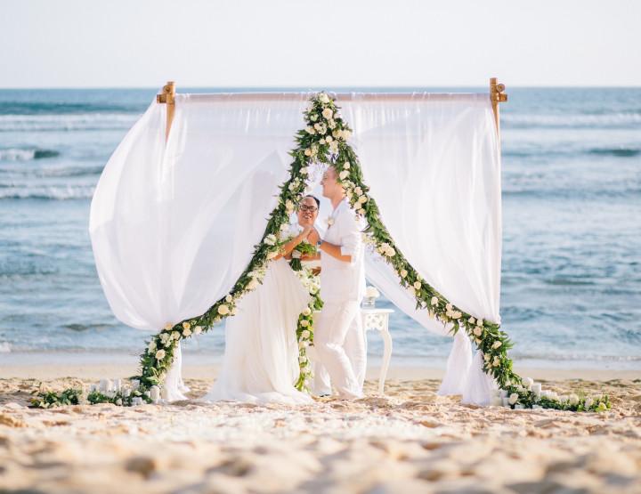 White Lotus Wedding on a white sand beach