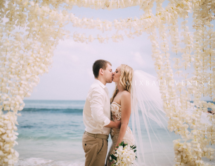 Wedding with Frangipani flowers hangings arch