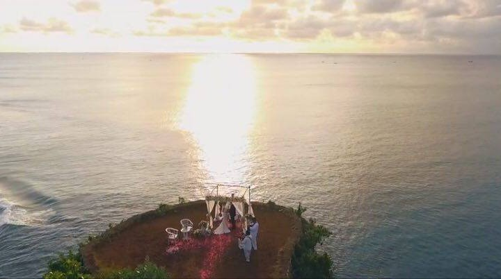 Wedding on a cliff over the ocean in Bali. Aero shooting - Raphael and Nelli