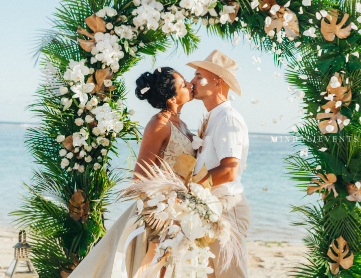 Stylish Tropical Wedding on the white sand beach in white and gold tones