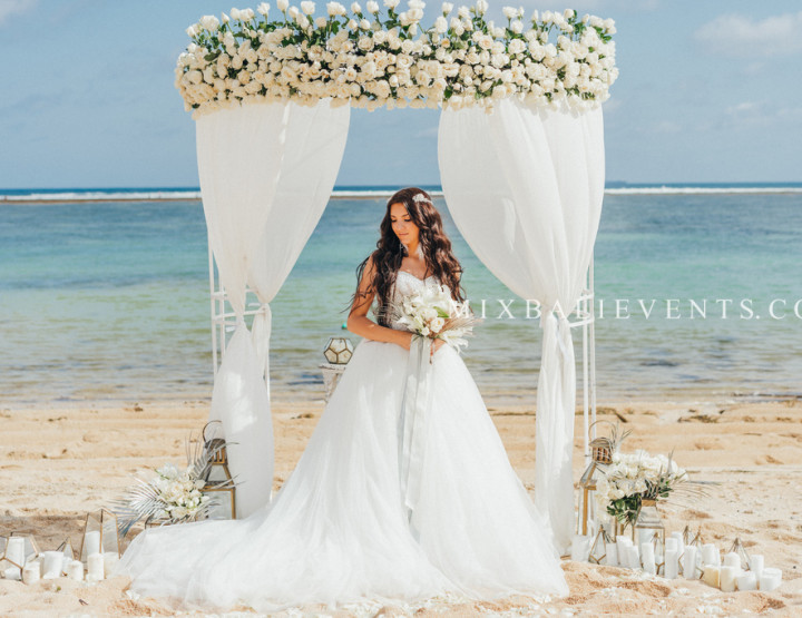 White Roses Wedding on a white sand beach