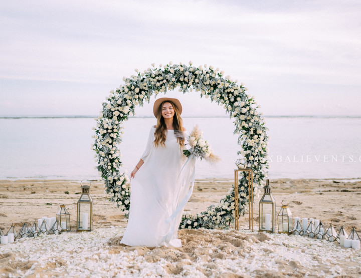 Trend 2019 — Wedding with a round arch in White & Gray colors. Wedding ceremony on the white sand beach