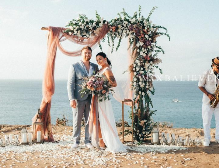 Stylish Boho Dark Pink Wedding on a cliff above the ocean